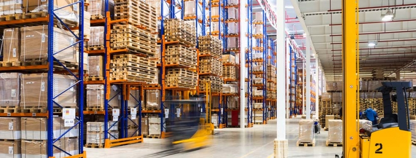Large modern warehouse with forklifts.